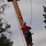 Photo Gallery: Teen Climbing Phone Pole During Team Day